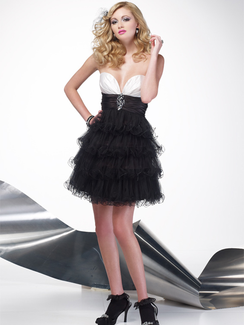 ...Flirty cocktail dress with deep sweetheart neckline and...